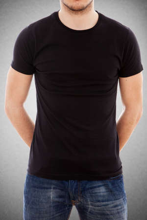 blank t shirt: Studio portrait of a young man in a blank black t-shirt Stock Photo