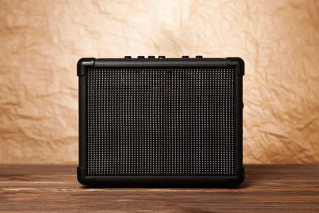 amplifier: Guitar amplifier on yellow background. Stock Photo