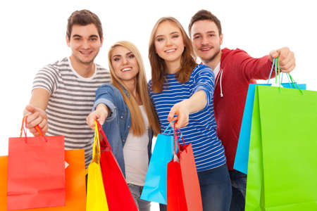 friends shopping: Group of young people shopping, isolated on white background Stock Photo
