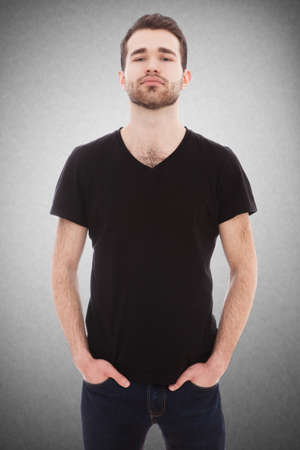 tee shirt: Portrait of a young man on grey background