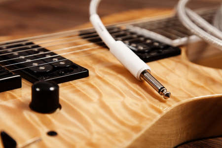 Modern 7 string electric guitar with natural finish Stock Photo