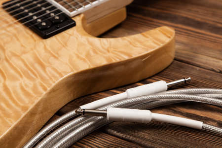 humbucker: Modern 7 string electric guitar with natural finish Stock Photo