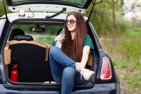 Young woman on a road trip. photo