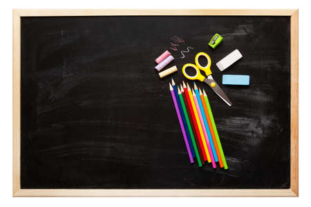 school supplies: School and office accessories on blackboard surface