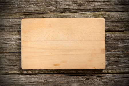 cutting: Cutting board on wooden background. Stock Photo