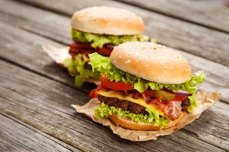 hamburger steak: Delicious hamburgers on wooden background