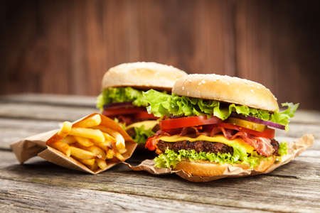 classic burger: Delicious hamburger and french fries on wooden background