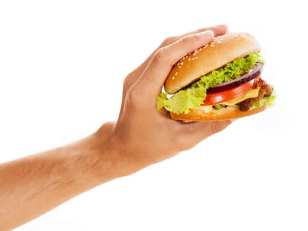 Hands holding a hamburger, isolated on white background