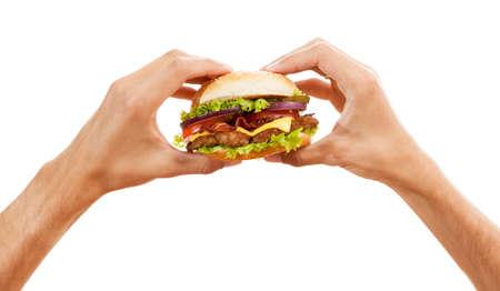 terra arrendada: Mãos que prendem um hamburger, isolado no fundo branco Imagens