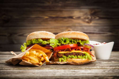 Delicious hamburger and french fries on wooden background 版權商用圖片 - 43063623