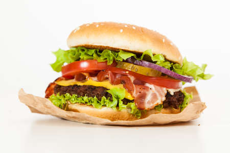 american cuisine: Delicious hamburgers on wooden background