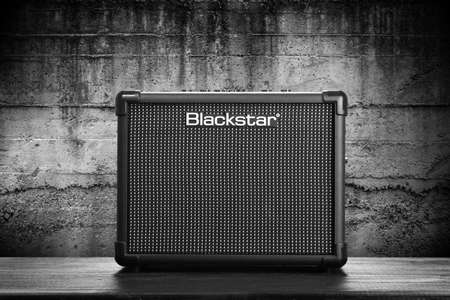 amplification: WROCLAW,POLAND - JUL 29, 2015: Blackstar Core ID 10 guitar amplifier. Blackstar Amplification is a UK-based manufacturer of guitar amplifiers and effects.