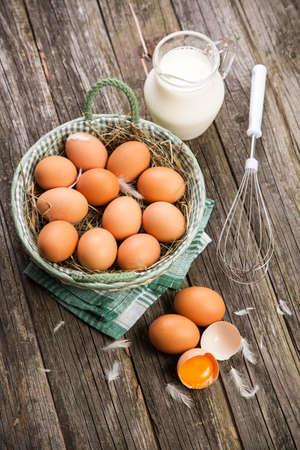 an egg shell: Fresh organic eggs in a basket Stock Photo