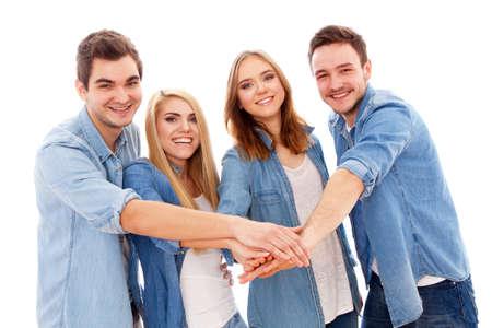 čtyři lidé: Skupina happy mladých lidí, izolovaných na bílém pozadí Reklamní fotografie