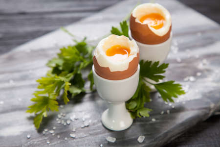 egg cups: Fresh boiled eggs on marble background