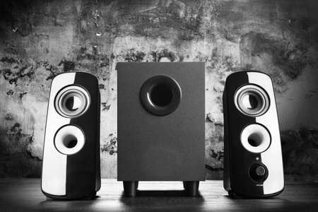 speaker: Modern black sound speakers on dark background