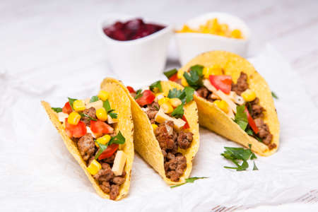 plates of food: Mexican food - delicious tacos with ground beef