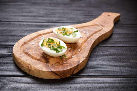 eggs: Boiled eggs on a cutting board.