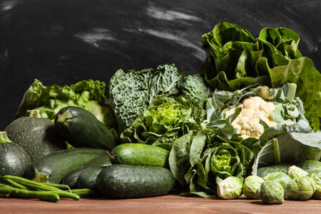 green vegetable: Assortment of green vegetables on wooden surface