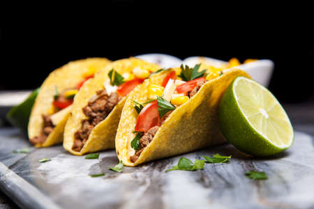 tacos: Mexican food - delicious tacos with ground beef