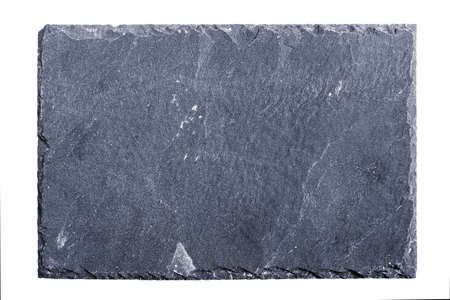 black stones: Rough textured slate board on white background Stock Photo