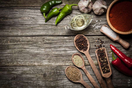 cutting boards: Variety of spices on a dark wooden surface