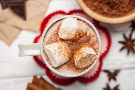 Cocoa drink with marshmallows and cinnamon Stock Photo - 47630066