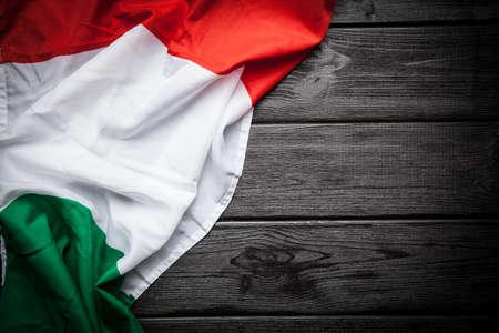 Flag of Italy on dark wood background