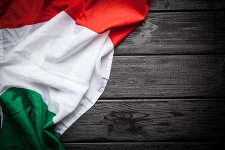 Flag of Italy on dark wood background