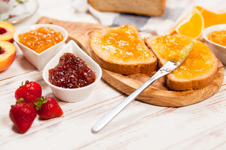 slices of bread: Slices of bread with jam for breakfast