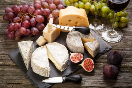 different types of cheese: Wine and cheese still life