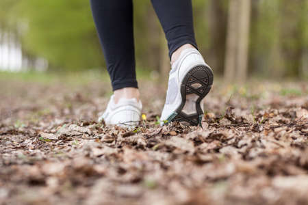 girl soles: Feet of a running woman in the forest Stock Photo