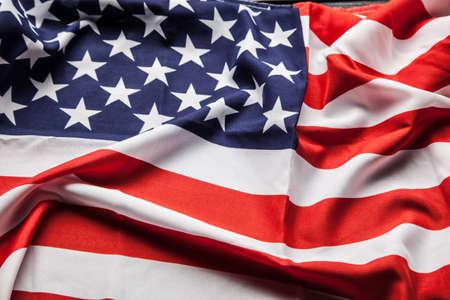 usa: Flag of USA on dark wood background