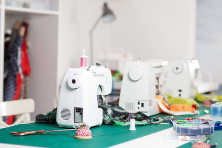 sewing machines: Several sewing machines in a workshop