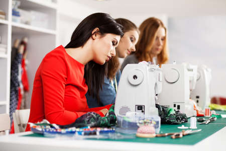 sewing machines: Group of women in a sewing workshop
