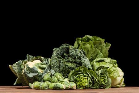 assortment: Assortment of green vegetables on wooden surface