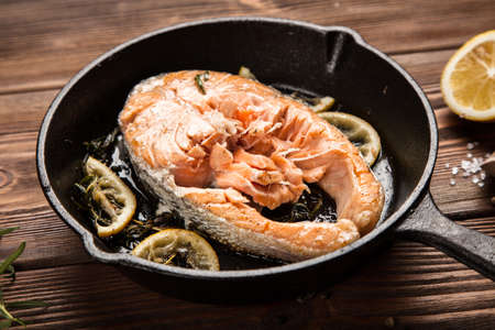 Salmon fried in a cast iron pan
