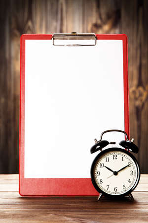 todo: Blank paper sheet for to-do list and alarm clock