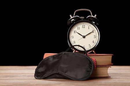 sleep mask: Vintage alarm clock and a sleep mask