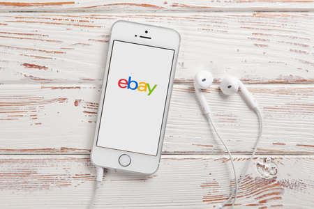 ebay: WROCLAW, POLAND - APRIL 12, 2016: Apple iPhone SE smartphone with eBay app on screen