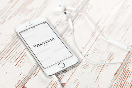 wiki wikipedia: WROCLAW, POLAND - APRIL 12, 2016: Apple iPhone SE smartphone with Wikipedia app on screen