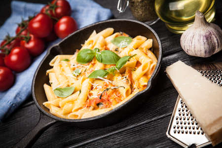 skillet: Traditional penne pasta in cast iron skillet Stock Photo