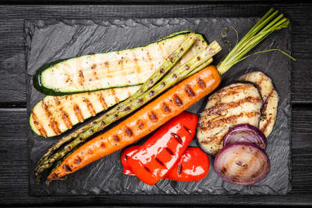 grilled vegetables: Assortment of grilled vegetables on dark background Stock Photo