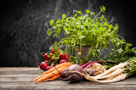 Fresh organic vegetables on wooden surface Stock Photo