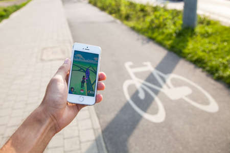 5s: WROCLAW, POLAND - JULY 31, 2016: Popular augmented reality game Pokemon Go on the screen of Apple iPhone 5s smartphone