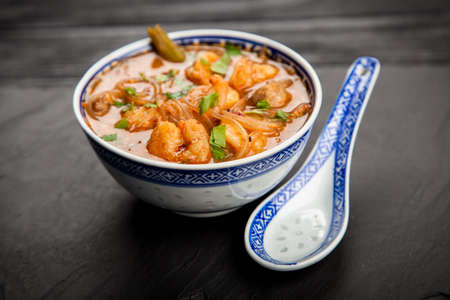 Traditional asian shrimp soup in a bowl
