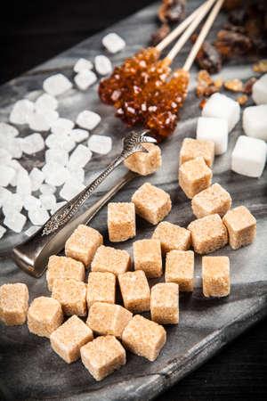 Different types of sugar on black backound