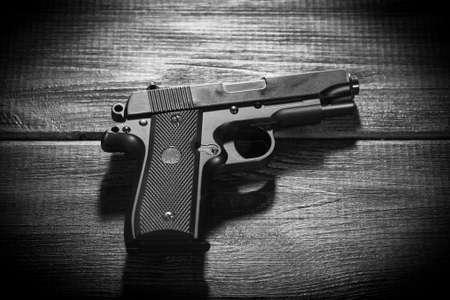 replica: Airsoft gun replica on dark background.