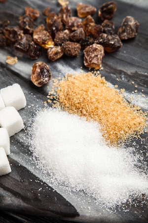 Different types of sugar on black backound