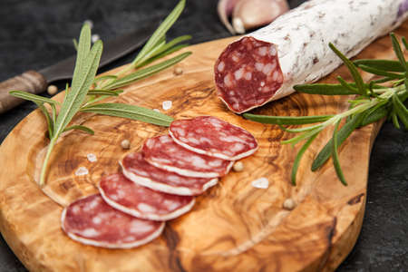 italian salami: Traditional italian salami on dark background